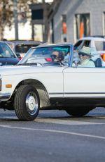 GWYNETH PALTROW Drives on Biden