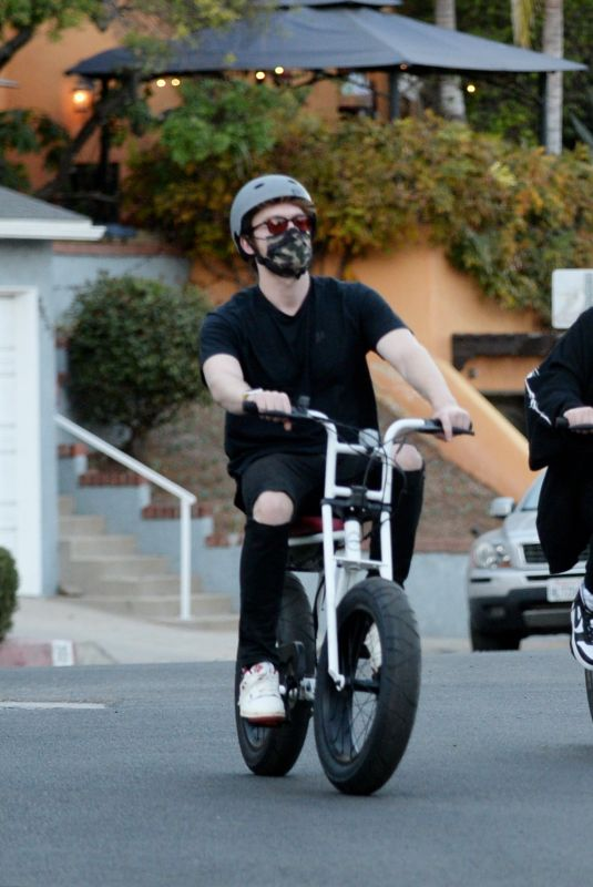 BILLIE EILISH and Finneas O'Connell Out Riding Bikes in Los Angeles 12/21/2020