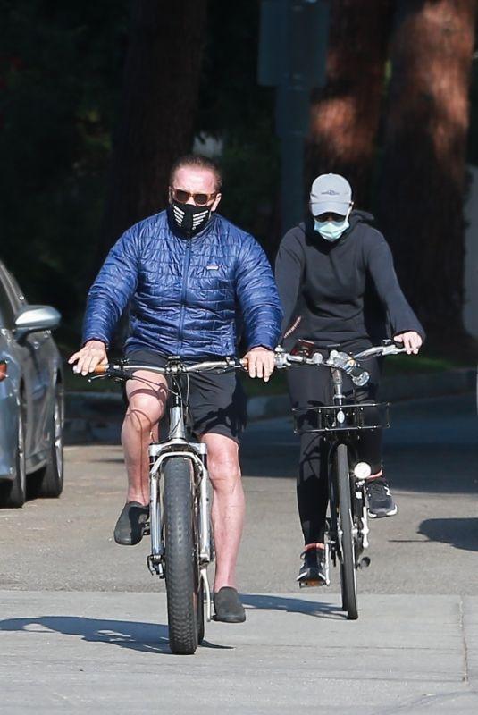 CHRISTINA and Arnold SCHWARZENEGGER Out Riding Bikes in Santa Monica 12/11/2020