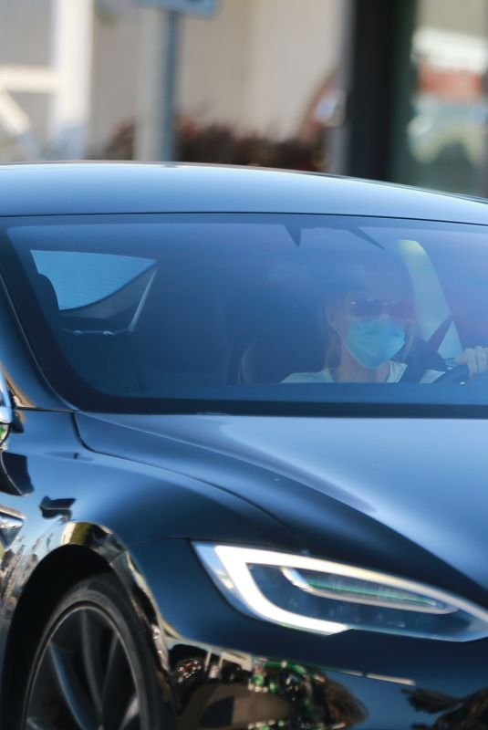 MICHELLE PFEIFFER Out Driving Her Tesla 11/30/2020