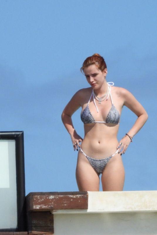 BELLA THORNE in Bikini at a Hotel Pool in Tulum 01/09/2021