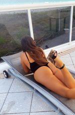 CLAUDIA ROMANI in Swimsuit in Miami Beach 01/22/2021