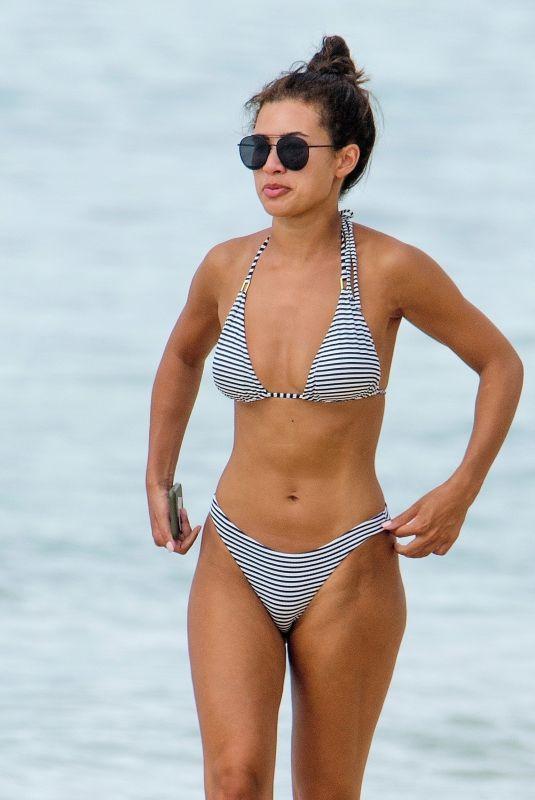MONTANA BROWN in a Striped Bikini at a Beach in Barbados 01/08/2021