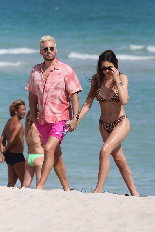 AMELIA HAMLIN in Bikini and Scott Disick at a Beach in Miami 02/12/2021