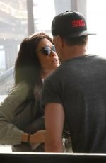 AUDRA MADRI and Josh Duhamel at LAX Airport in Los Angeles 02/04/2021