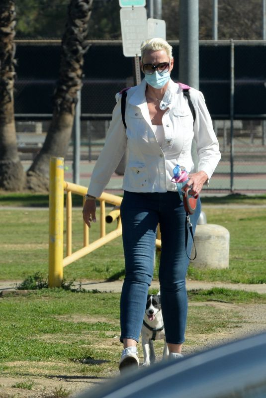 BRIGITTE NIELSEN Out with her Dog at a Park in Los Angeles 02/07/2021
