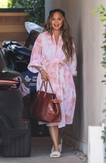 CHRISSY TEIGEN Checking on the Site of Her New Mansion in West Hollywood 02/16/2021