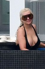 CHRISTINA AGUILRA in Swimsuit at a Pool in Miami 02/12/2021