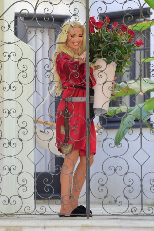 ERIKA JAYNE Receiving Flowers Outside Her Home in Los Angeles 02/13/2021