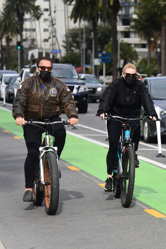 HEATHER MILLIGAN and Arnold Schwarzenegger Out Riding Bikes in Santa Monica 02/13/2021