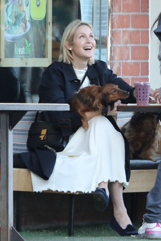 KELLY RUTHERFORD Out with her Dogs at Kreation Organic in Beverly Hills 02/18/2021