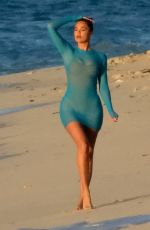 KHLOE KARDASHIAN at a Photoshoot on the Beach in Turks and Caicos 01/28/2021