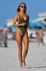 KIMBERLEY GARNER in Swimsuit at a Beach in Miami 02/05/2021