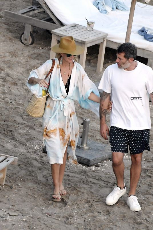LAETICIA HALLYDAY and Jalil Lespert Out at a Beach in St. Barths 02/18/2021