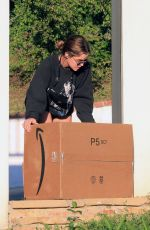 LUCY HALE Collects Some Packages Outside Her Home in Los Angeles 02/24/2021