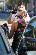MILEY CYRUIS Out with her Dog in Beverly Hills 02/22/2021