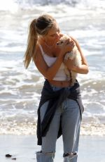 ALEXIS REN Out with Her Dog at a Beach in Malibu 03/01/2021