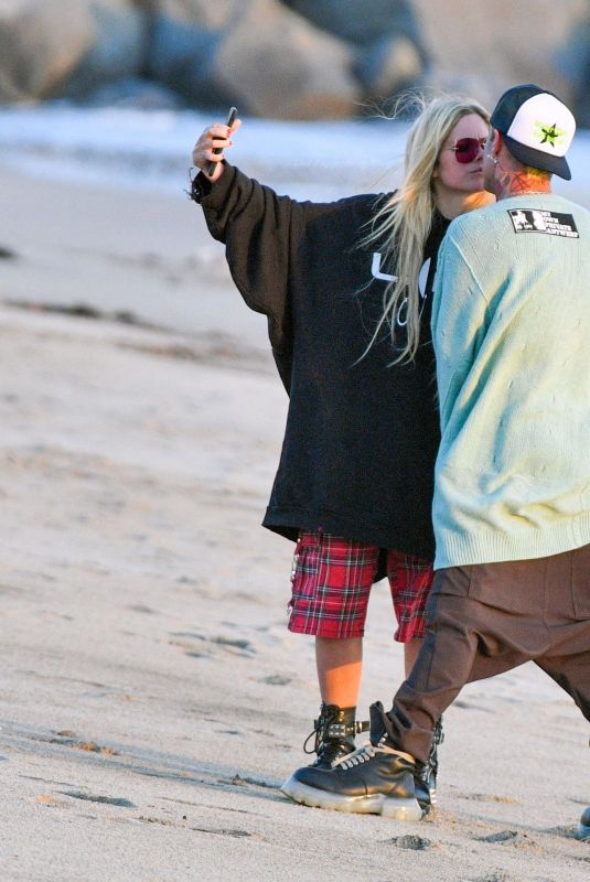 AVRIL LAVIGNE and Mod Sun Out at a Beach in Santa Monica 03/11/2021