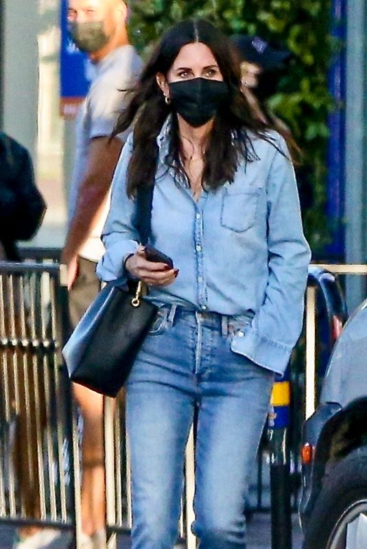 COURTENEY COX in Double Denim Out Shopping on Melrose Place in West Hollywood 03/18/2021