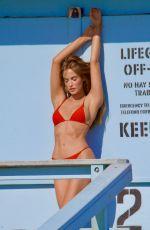 HALEY KALIL in a Red Bikini at a Photoshoot in Malibu 03/16/2021
