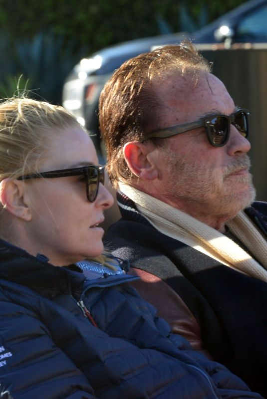 HEATHER MILLIGAN and Arnold Schwarzenegger Out Driving in Los Angeles 03/13/2021