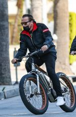 HEATHER MILLIGAN and Arnold Schwarzenegger Out Riding Bikes in Santa Monica 03/13/2021