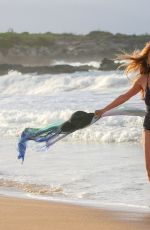 JANE SEYMOUR in a Blac Swimsuit at a Beach in Hawaii 03/11/2021