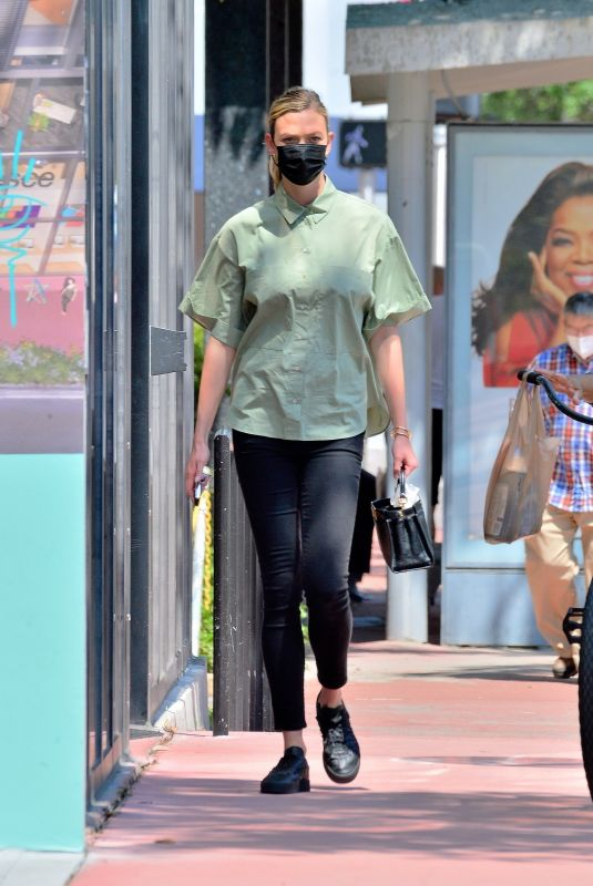 KARLIE KLOSS Out and About in Miami 03/24/2021
