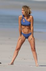 LARA BINGLE in Bikinis at a Photoshoot on the Beach in Sydney 03/04/2021