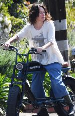 LENA HEADEY Rides Electric Motorbike Out in Los Angeles 03/16/2021