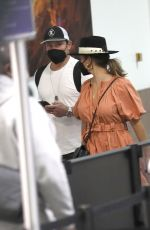 VANESSA MINNILLO Arrives at LAX Airport in Los Angeles 03/23/2021