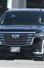 ANNE HATHAWAY and Adam Shulman Out Driving in Los Angeles 04/26/2021