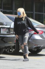MALIN AKERMAN in Ripped Denim Out in Los Angeles 04/10/2021