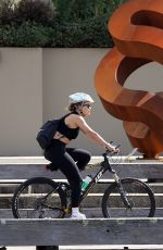 RITA ORA Out Riding a Bike at Harbour in Sydney 04/14/2021