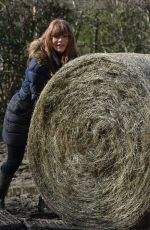 SUMMER MONTEYS-FULLAM Pushing a Bale of Hay at a Field in London 04/05/2021