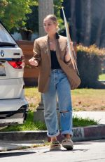 ASHLEE SIMPSON Picks up a For Sale Sign from Her Old House in Sherman Oaks 05/25/2021