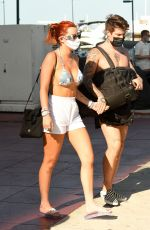 BELLA THORNE in Bikini Top Arrives at a Yacht in Miami 05/05/2021