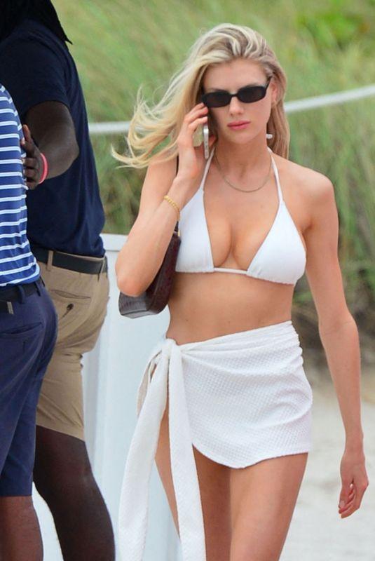 CHARLOTTE MCKINNEY in Bikini at a Pool in Miami 05/17/2021