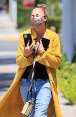 CHRISSY TEIGEN Leaves a Business Meeting in Los Angeles 05/28/2021
