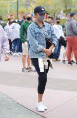 CHRISSY TEIGEN Out at Disneyland in Los Angeles 05/15/2021