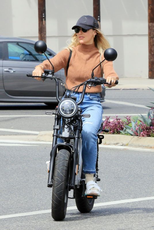 EMMA SLATER Riding Electric Bike Out in Los Angeles 05/01/2021