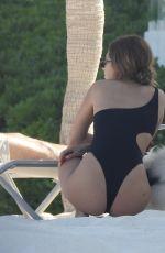 FRANCESCA FARAGO in a Black Swimsuit at a Beach 05/18/2021
