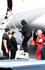 KYLIE JENNER and Travis Scott Boarding on a Jet in Miami 05/03/2021