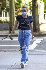 LILI REINHART in Ripped Denim Out with Her Dog in Vancouver 05/02/2021