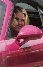 MICHELLE HUNZIKER Out Driving Her Porsche in Milan 05/12/2021