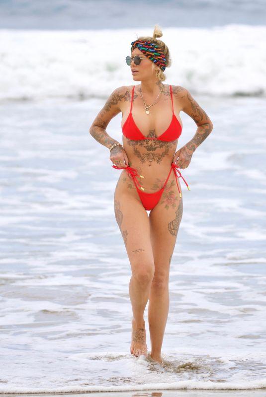 TINA LOUISE in a Red Bikini at Venice Beach 05/17/2021