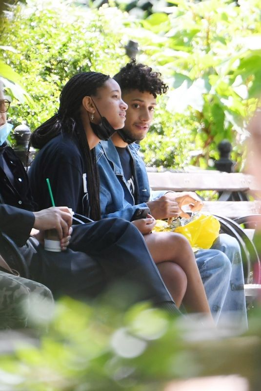 WILLOW SMITH and Tyler Cole Having Lunch on a Bench in Union Square Park 05/25/2021