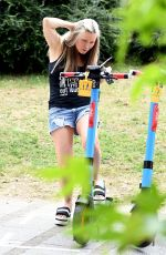 CAPRICE BOURRET in Denim Shorts Out at a Park in London 06/16/2021
