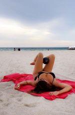 CLAUDIA ROMANI in Bikini at a Beach in Miami 06/19/2021