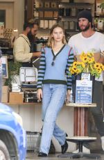 GABRIELLA BROOKS and Liam Hemsworth Out Shopping in Byron Bay 06/27/2021